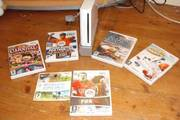 nintendo wii with 5 games